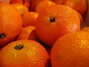 Macro shot of a box of clementines.